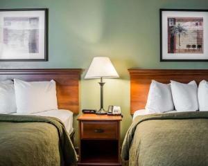 A bed or beds in a room at Quality Inn & Suites Near Fairgrounds & Ybor City