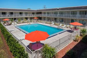 The swimming pool at or near Rodeway Inn Kissimmee Main Gate West