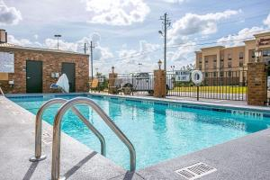 The swimming pool at or near Comfort Inn & Suites - Fort Gordon
