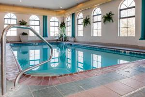 The swimming pool at or near Quality Inn Seymour I-65