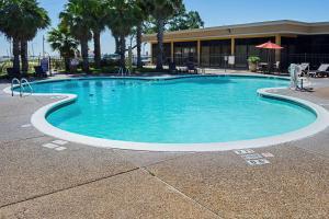 The swimming pool at or near Quality Inn Biloxi Beach