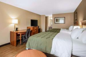 A bed or beds in a room at Quality Inn & Suites University Area