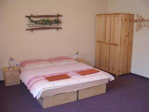 Posteľ alebo postele v izbe v ubytovaní Skipension Jasná