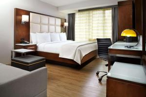 A bed or beds in a room at Cambria Hotel New York - Chelsea