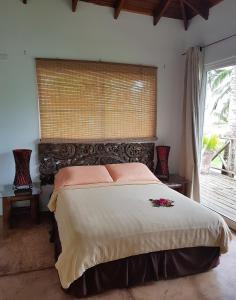 Cama ou camas em um quarto em Playa Tranquilo B&B and Dive Shop