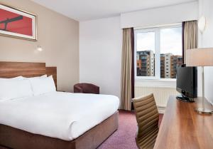 A bed or beds in a room at Jurys Inn Newcastle