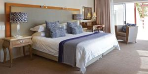 A bed or beds in a room at The Bay Hotel