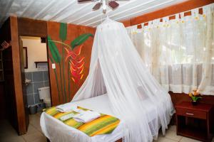 A bed or beds in a room at Avatar Amazon Lodge