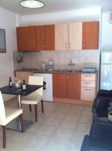 A kitchen or kitchenette at Marika's Apart's & Studios