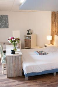 Un ou plusieurs lits dans un hébergement de l'établissement Hotel Kijkduin