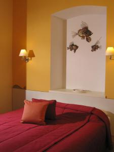 A bed or beds in a room at Mare Mare Suites