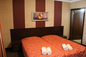 A bed or beds in a room at Hotel-restaurant Almond