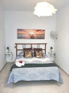Un ou plusieurs lits dans un hébergement de l'établissement Apartamento Anaca