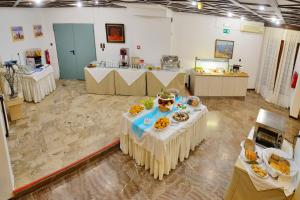 A restaurant or other place to eat at Elena Beach Hotel