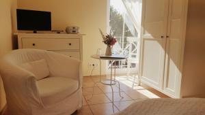 Ein Sitzbereich in der Unterkunft Hotel Garni Auszeit