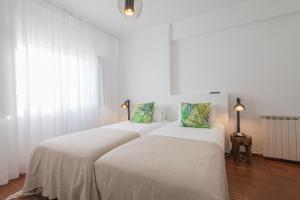Uma cama ou camas num quarto em CASA DA EIRA Boutique Houses