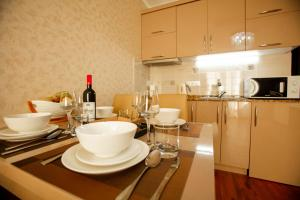 A kitchen or kitchenette at Aparthotel Holiday Lux Batumi