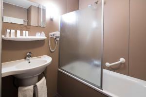 Een badkamer bij Hotel Lands End