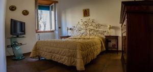 A bed or beds in a room at B&B A Un Passo Dal Mare