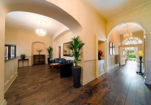 The lobby or reception area at Best Western Leigh Park Hotel