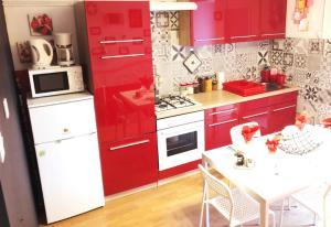A kitchen or kitchenette at Apartments Ruža