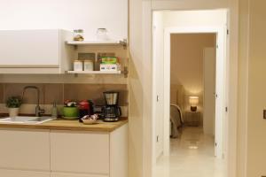 A kitchen or kitchenette at HomeAway Salerno
