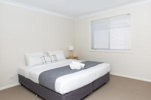 A bed or beds in a room at Lovely 3 Bed, 2 Bath in the City Centre