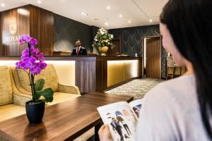 The lobby or reception area at Best Western Plus Royal Suites