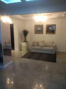 A seating area at Apartamento Itapema ou Meia Praia