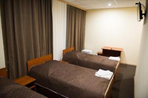 Кровать или кровати в номере Hotel Agata