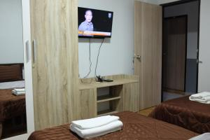 A television and/or entertainment centre at WJ Residence at Suvarnaphumi
