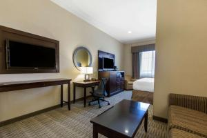 A television and/or entertainment center at The Oaks Hotel & Suites, Ascend Hotel Collection