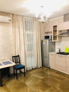 Кухня или мини-кухня в Apartment Kutuzoff Metro Kievskaya