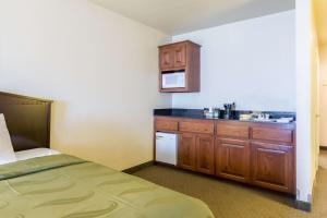 A bed or beds in a room at Quality Inn and Suites Alma