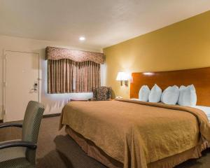 A bed or beds in a room at Quality Inn Santa Cruz
