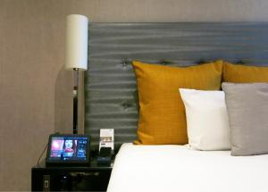 A bed or beds in a room at K West Hotel & Spa