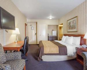 A bed or beds in a room at Quality Inn Toronto Airport