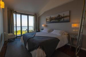 Cama o camas de una habitación en Hotel Arbe