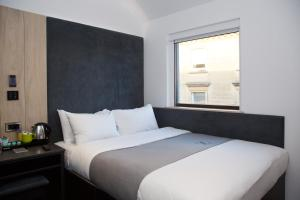 A bed or beds in a room at The Z Hotel Bath