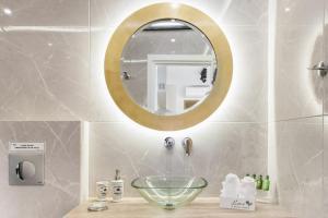 A bathroom at The Athenians Modern Apartments