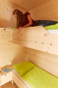 A bed or beds in a room at Arena Hostel Allgäu