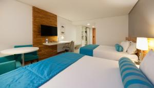 A bed or beds in a room at Best Western Premier Maceió