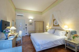 Cama ou camas em um quarto em Hotel Davanzati