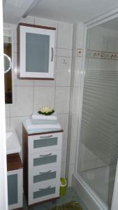 Ein Badezimmer in der Unterkunft Ferienhaus Scheper