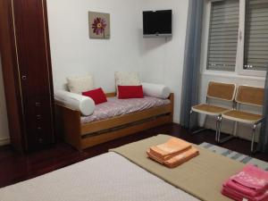 A bed or beds in a room at Palm Guesthouse B&B Rooms