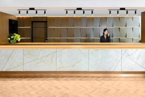 The lobby or reception area at Adina Apartment Hotel Melbourne Northbank