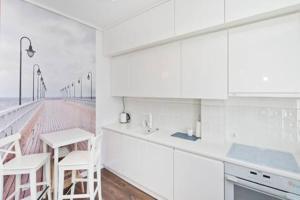 A kitchen or kitchenette at YOURAPART Sopot Centrum Plaza