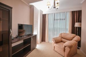 Телевизор и/или развлекательный центр в Zastava Hotel