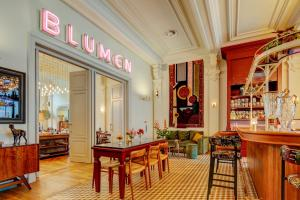 A restaurant or other place to eat at Hotel Mercier