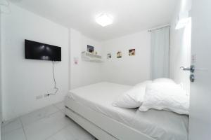 Cama ou camas em um quarto em Galinha d'Angola